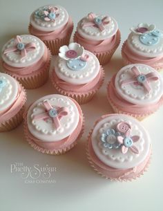 Pretty buttons, bows and flowers pink and blue cupcakes - sew lovely!