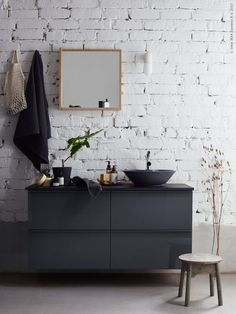 home decor / interior design / black dresser / ikea / white brick / modern