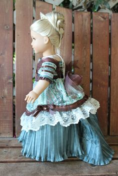 1870's evening gown with tiara comb and slippers for 18in American girl dolls. $48.50, via Etsy.