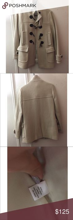 ✂️price drop✂️ NWOT BANANA REPUBLIC WOOL JACKET Brand new, never worn. Banana republic cream colored wool jacket with brown buttons. Size is small. True to size.  Posh rules only  No paypal No lowballing  Price firm unless bundled.  I'm a suggested user and party host, posh ambassador, posh mentor, and I'm five star rated so buy with confidence!  H A P P Y  P O S H I N G  ⭐️✨⭐️✨⭐️✨✨⭐️✨⭐️✨⭐️ Banana Republic Jackets & Coats Pea Coats