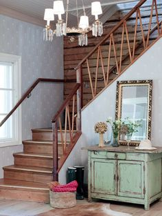 Those stairs. What a welcome home. Farmhouse Plans, Vintage Farmhouse, Farmhouse Design, Wooden Staircases, Sofa Colors, Interior Concept, Storage Places, Wooden Cabinets, Living Room Paint