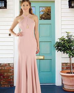 Beautiful and elegant Span Satin long dress with criss-cross bodice and back zip closure. This long evening gown comes in Green, Mauve and Turquoise colors. POLY USA