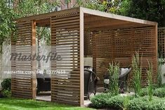 Slatted cedar pavilion on the right side of the lawn on the upper level of the garden. Silver birches along the boundary wall. Hebe and grasses on the right. Architects: Modular – Image © Arcaid / Masterfile.com: Creative Stock Photos, Vectors and Illustrations for Web, Mobile and Print Diy Pergola, Wood Pergola, Outdoor Pergola, Outdoor Rooms, Backyard Patio, Outdoor Living, Modern Backyard, Backyard Ideas, Pergola Lighting