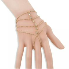 Gold tassel bracelet / ring * 22 aviliable * Colour: Gold  Material:Alloy+Crystal  Size:Wrist Chain length: 13+5cm  Back of the hand chain length: 6cm  Quantity:1pc Jewelry Bracelets