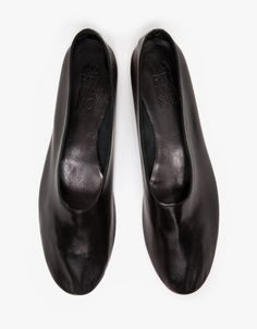 Elegant, handmade slip-on flat from Martiniano with a rounded toe. Features supple leather uppers, high instep, padded insole, and a stacked leather heel with rubber heel cap.   •Slip on leather flat shoe •Stacked leather heel •Rubber heel cap