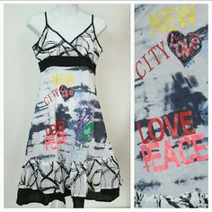 "📣SALE🎉Urban Chic dress NWT 🌟🌟🌟🌟🌟 BRAND NEW with tags ""Life is Peaceful"" Urban Chic dress. Dress features tons of details including colorful writing, beaded details and threaded details. Ruffle detail around bottom.   Adjustable straps Length is approx 38"" but will vary depending on were you adjust your straps 100% cotton Dresses"