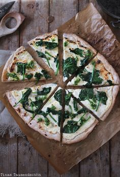 Pizza Bianca with spinach and macadamia nut pesto