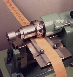 Belt Embossing Machines  With high pressure and heated rollers which deeply emboss patterns and mock stitching along leather belts and straps. Can apply gold and other colour foils. Can also cut zig-zag or scalloped edges.