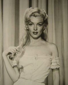 marilyn, on of the very few pictures of her with long hair as Marilyn and not Norma jean