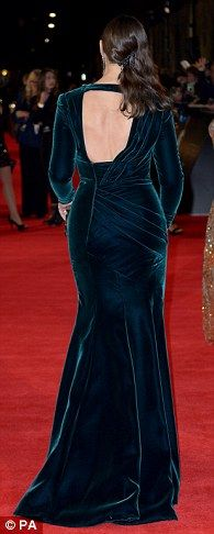Green with envy: Monica showed off her fabulous curves in a clinging green velvet backless gown with plunging neckline and thigh-high split