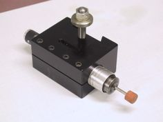 Tool Post Grinder by  -- Homemade tool post grinder constructed from an air grinder and a custom QCTP adaptor. http://www.homemadetools.net/homemade-tool-post-grinder-5