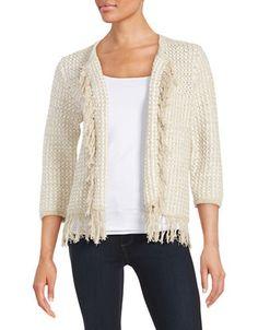 "<ul> <li>Dynamic open-front knit with carefree fringe trim</li> <li>Open front</li> <li>Three-quarter length sleeves</li> <li>About 23"" from shoulder to hem</li> <li>Cotton/nylon/acrylic</li> <li>Hand wash</li> <li>Imported</li> </ul>"