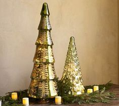 undefined Pottery Barn galss trees with a spot for string lights