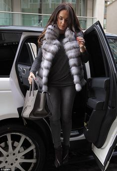 Tamara Ecclestone.. dressed all in grey with a white faux fur gilet.. maternity-sophisticate..