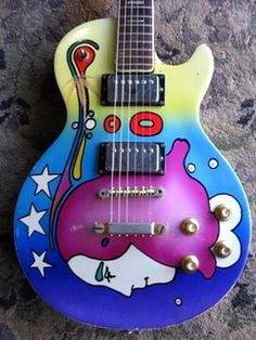 """1968 Univox Les Paul """"Law Suit"""" guitar with custom paint job from the era."""
