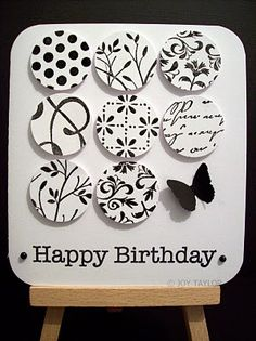 black and white card with the nine patch done in circles, each one stamped with a different image...