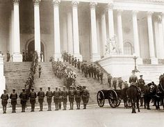 Coffin of the Unknown Soldier being brought down steps of the U.S. Capitol, 1920.