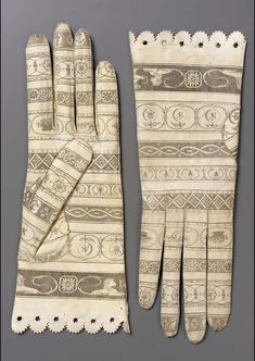 Pair of women's gloves, Spain, late 18th century. White leather printed in black with ornamental motifs.