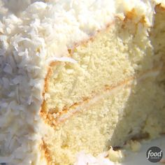 Coconut Cake Celebrate with Ina Garten's snow-white Coconut Cake recipe from Barefoot Contessa on Food Network. The cream cheese frosting is sprinkled with shredded coconut. - The best Coconut Cake you will ever have! Cake Recipes From Scratch, Best Cake Recipes, Dessert Recipes, Moist Coconut Cake Recipe From Scratch, Coconut Creme Cake Recipe, Brandy Cake Recipe, Almond Cake Recipes, Best Coconut Cake Recipe Ever, Swedish Almond Cake Recipe