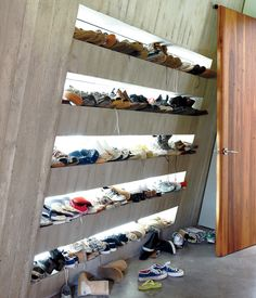 Modern Angular Rural Family Home in Canada - Photo 7 of 13 - Just off an internal courtyard, a mudroom provides a prime place to keep sneakers. Each family member has their own shelf, backlit by windows that illuminate every pair. Sneaker Storage, Shoe Storage, Storage Ideas, Sneaker Rack, Storage Room, Storage Solutions, Shoe Wall, Modern Hallway, Internal Courtyard