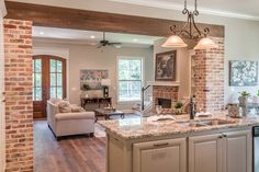 4 Bed Exclusive French Country House Plan with Rear-Access Garage - - 13 - House Plans, Home Plan Designs, Floor Plans and Blueprints House Design, Brick Archway, Brick Exterior House, House Plans, French Country House Plans, Brick Columns, French Country Bathroom, Country Kitchen, French Country Kitchens