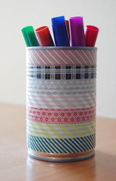 Decorate a can with tape and it becomes a designer pen holder, nice!