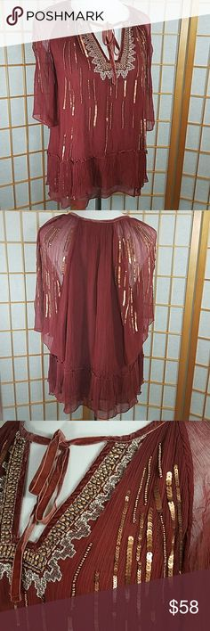 """Anthropologie Floreat Canalis keyhole blouse Anthropologie Floreat Canalis keyhole blouse. Gorgeous maroon color with velvet tie at neck, flutter sleeves, and gold and copper sequins and beading throughout. Shows light wear, has some missing sequins on back shoulder, but still looks fabulous. Size Medium, measures 17""""across from armpit to armpit when laid flat and is  20"""" long from back neckline to hem. Anthropologie Tops Blouses"""
