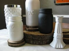 Hot glue words on mason jars and then matte spray paint over it.