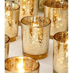 "Perfect wedding decorations that add a stunning look to your wedding table décor with these David Tutera™ mercury glass votive candle holders in spotted gold. 12 votives per pack. - 2.5"" Tall - 2.25"""