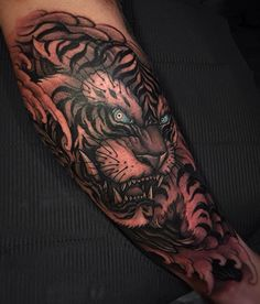 Tiger tattoo with blue eyes