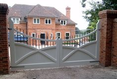 A scissor braced pair of entrance gates