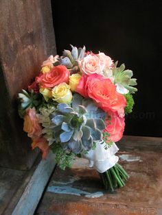 Succulent and garden rose bridal bouquet in corals, lemony yellows.  Worcester florists - Sprout