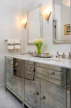 Maybe too glam for you, but this could keep that bathroom incredibly light - Jessica Lagrange Interiors: Gorgeous art deco bathroom with antiqued mirror double bathroom vanity with calcutta . Decor, Mirrored Furniture, Interior, Mirror Cabinets, Art Deco Bathroom, Cheap Home Decor, Hollywood Regency Bathroom, Bathroom Design, Bathroom Decor
