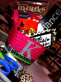 Drill Team tryout--Good Luck basket!  hot pink basket--3.99  zebra print/lime green ribbon--99 cents each.  sticker-- 1.05  alll from Hobby Lobby :)  added whatever you'd like on the inside! <3