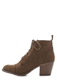 Press Playlist Bootie in Brown. As soon as you press play on your fave jams, lace up these brown ankle boots, because your style is sure to rock right alongside the energetic songs. #brown #modcloth