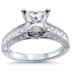 <li>White diamond engagement ring</li><li>18k white gold jewelry</li><li><a href='http://www.overstock.com/downloads/pdf/2010_RingSizing.pdf'><span class='links'>Click here for ring sizing guide</span></a></li>