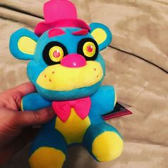 Check out the Five Nights at Freddy Blacklight Plushies! Here is Neon Blue Freddy