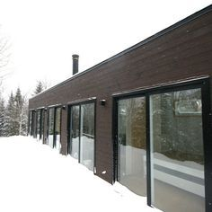 An old shipping container has found new life as a modern small-scale residence at the foot of the ski mountain Massif du Sud in Quebec, Canada. LOKI Homes..
