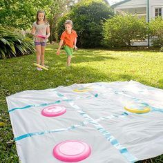 Disk Tic-Tac-Toe Supersize tic-tac-toe is perfect for an outdoor birthday party. Flying disks and a shower curtain transform into an easy party game.
