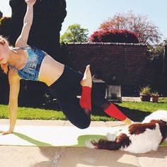 Outdoor yoga in the sunshine - half lotus side plank    Get 20% off your first activewear order    www.akafit,co,uk