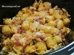 Cheesy chicken tater-tot casserole in  slow cooker.  Ingredients:  1 (32 oz.) bag frozen tater tots  1 (3 oz.)bag bacon pieces  1 pound boneless, skinless chicken breasts, diced  2 cups shredded cheddar cheese  3/4 cup milk  salt & pepper, to taste