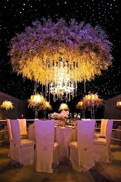 Dramatic floral installation and up-lighting