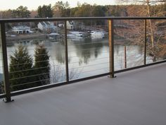 Lake front deck with Bronze cable railings with Light Grey LockDry decking.