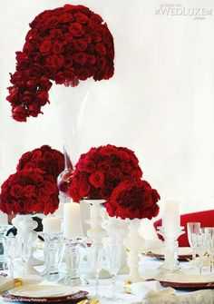 gorgeous red wedding centerpieces   We Love These Gorgeous Red Rose Centerpieces on WedLuxe !}