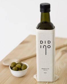 White cloth olive oil packaging ---- I like the label but I wish the corners of the fabric fit more snugly.