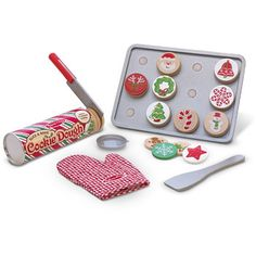 "Melissa & Doug Slice & Bake Christmas Cookie Play Set. This colorful play-food set includes a tube of 12 sliceable cookies with 12 decorative toppings, an oven mitt, wooden cookie sheet, knife and spatula, plus ""baking"" directions to encourage unlimited imaginative play and learning. It's a festive way to reinforce basic skills, encourage creativity and celebrate the holidays!"