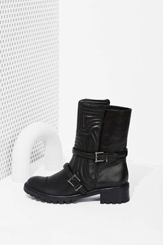 These moto boots by Schutz are about to be your ride or die black boots this fall.