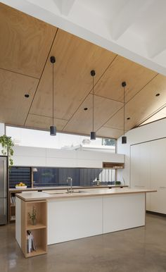 Plywood ceiling with seams, black canned lights, pendants & fans. : Plywood ceiling with seams, black canned lights, pendants & fans. Storage shelves added to end/under bar & kitchen Plywood Ceiling, Plywood Walls, Home Decor Kitchen, Kitchen Interior, Kitchen Design, Bar Kitchen, Kitchen Cabinets, Home Design, Home Interior Design