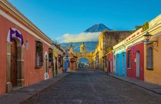 Antigua, Guatemala About an hour from Guatemala City, this former capital is a relic of colonial Spain. Just beyond the Crayola-colored town are three giant volcanoes, which make for some pretty spectacular day trips. Tikal, San Salvador, Central America, South America, Puerto Quetzal, Honduras, Best Solo Travel Destinations, San Pedro, Guatemala City