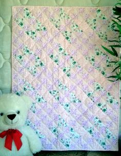 Baby Pink Giraffes is a unique handmade baby quilt - just perfect for a baby shower gift idea.